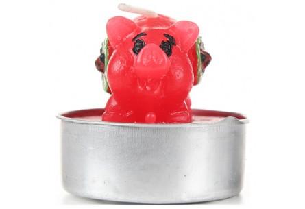 Świeczki w kształcie radosnych świnek